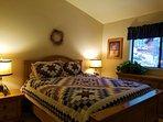 Bedroom Three, upstairs.  Queen bed.