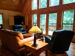 Beautiful chalet windows and doors exit to the patio.