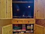 Living Room entertainment center.  Plenty of games for indoor days.