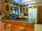 Stylish kitchen w/ bar stools at the breakfast bar.