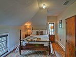 A 4-poster bed is featured in this first bedroom.