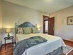 Hardwood floors run throughout the bedrooms.