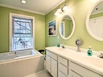 The master bath hosts a jetted tub and flat-screen cable TV.
