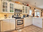The spacious kitchen is fully equipped.