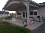 Back covered patio with BBQ and seating