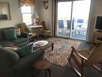 oceanfront living room open to large upper level deck