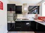 Modern, well equipped kitchen with double oven, gas hob and washer/dryer