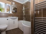 Main bathroom with P-Shape shower bath, electric shower & chrome towel warmer (refurbished 2017)