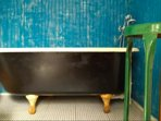 Antique claw foot tub with penny tile floor, old world meets shabby chic funky Nola styles