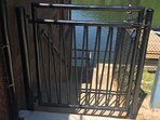 Locked gates to prevent young children access to lakefront.