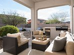 Spacious covered patio with plenty of seating and built-in BBQ.