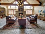 Relax by the fire in the common area of Gateway Lodge.