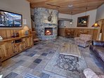 Sit by the fireplace in the common area of Jack Pine
