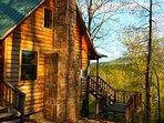 Cabin sits high above the river and surrounding hills.