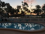 Sunset view accented with trees by the pool.