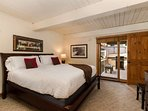 The master bedroom has a king bed, en-suite bath, entrance to the balcony and a flat screen TV.