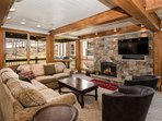 This Top of the Village condo has a view of the ski slope, a balcony with a gas grill, a gas fireplace and a flat...