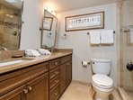 The master bath has granite countertops, a double vanity and beautifully tiled shower.