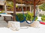 Beach palapa and hammocks