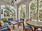 The screened porch, with lots of plush seating, is right next to the private pool on the first floor.