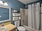 A traditional shower/tub combo completes the en-suite bathroom.