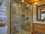 Return home from a hike and rinse off in this pristine walk-in shower.