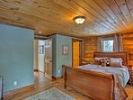 The beautiful woodwork found in the living area extends to the bedrooms.