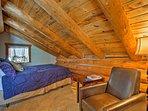 Log beams distinguish the upstairs bedroom.