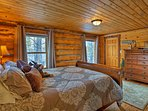 The master bedroom houses a queen-sized sleigh bed.
