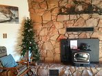 Cozy up to the wood burning stove in the cooler months.