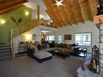 Spacious living area with soaring ceilings