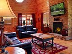 Comfortable seating in main living room area with Flat Screen TV and Seasonal Fireplace