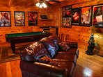 The game room features pool table, wet bar with microwave, TV and fireplace and arcade game.