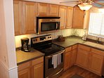 Kitchen, Corian counters, stainless appliances and hardwood cabinets