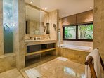Master bedroom ensuite with separate shower and bath.