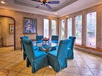Enjoy home-cooked meals around the formal dining table that offers pleasing views through the wall of windows.