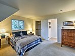 A queen bed completes this master bedroom.