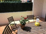 Sunny terrace has room for sunbathing (2 sunbeams provided), outdoor eating and cooking a la plancha