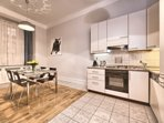 Modern, fully equipped kitchen with dining area