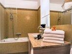 Full bathroom with bath