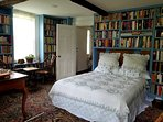 Library Bedroom with its chess table, rocking chairs and desk.