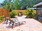 Beautifully landscaped outdoor patio with lots of seating space and room for Fido to play!