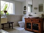 The Master Bathroom with Jacuzzi, towel warmer and Indonesian vanity and tile.