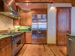 In the kitchen you'll find sleek stainless steel appliances, including a 6-burner gas stove.