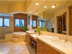 Two vanities and a separate shower and tub make it a treat to get ready in the Master Bathroom.