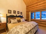 The third guest bedroom also has a split king bed, set under a cozy sloped ceiling.