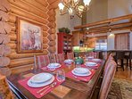 The large wood dining toom table can seat up to 10 guests.