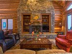 Gather around the coffee table with a fire glowing in the traditional fireplace.