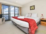 The master bedroom has stunning views of the viaduct and a small tv