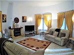 Spacious and comfortable living room with air con, Wi-Fi, UK & Spanish TV & DVD player and DVDs